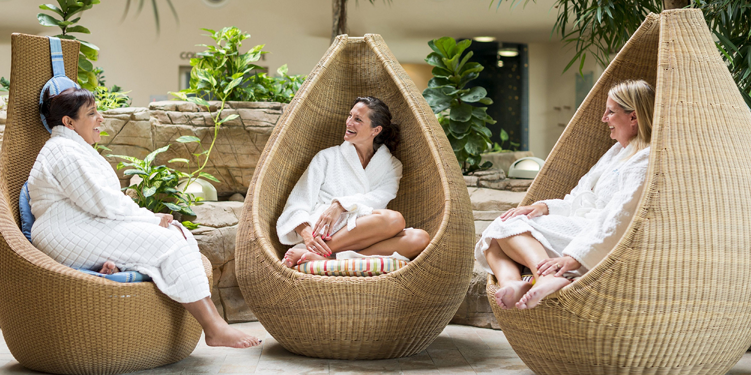 3_ladies_chatting_in_wicker_pods_(side_view)_FOR_WEB
