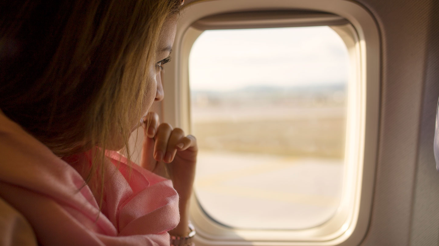 woman-by-aeroplane-window