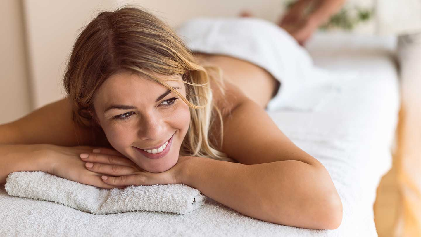 happy-blonde-woman-having-a-massage