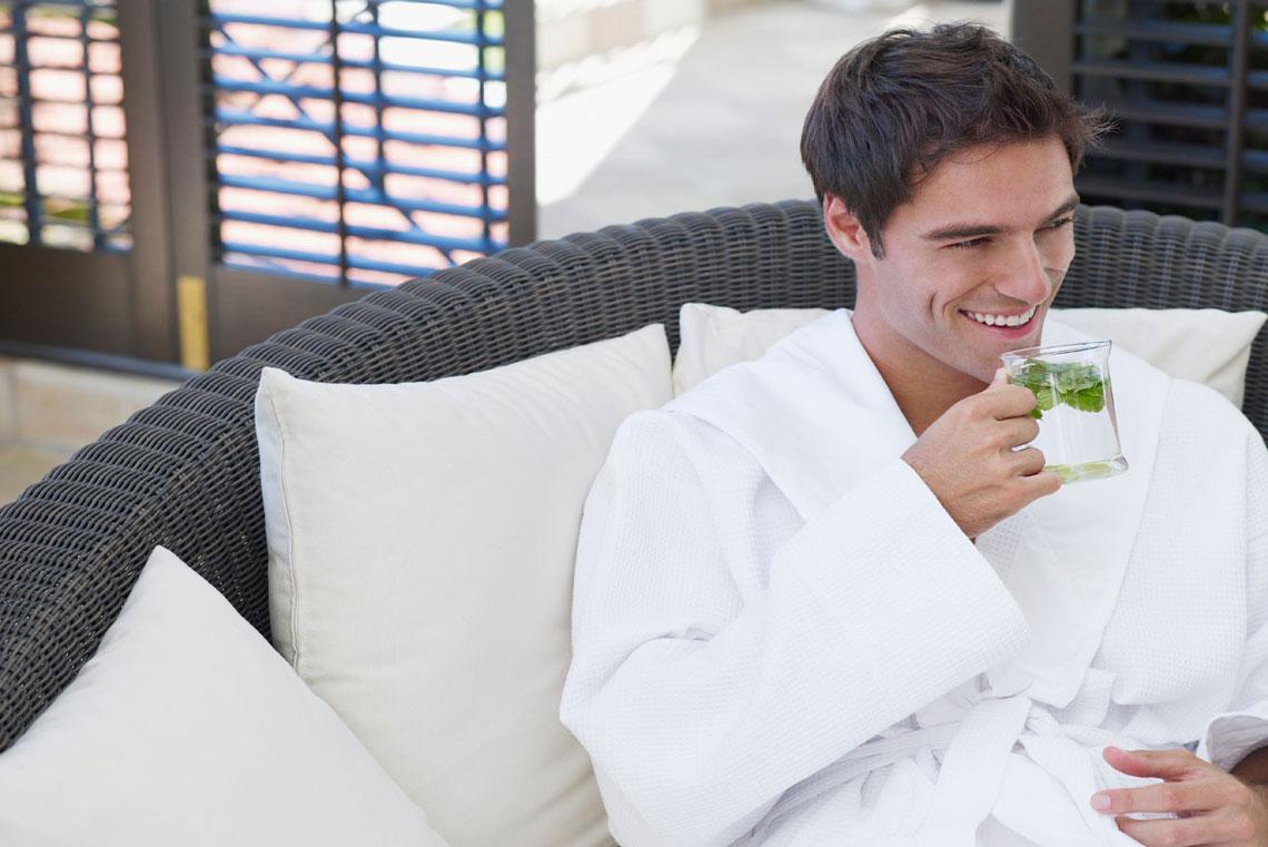 man drinking tea in robe