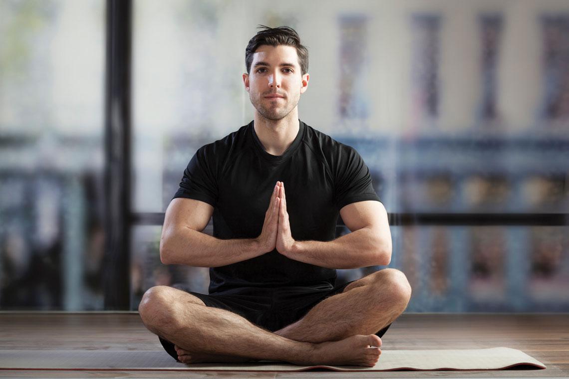 man sitting down meditating