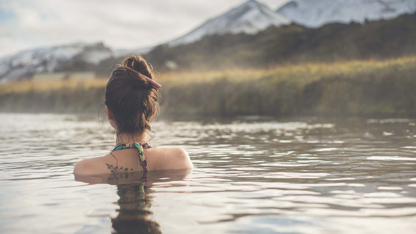 Woman in outdoor natural pool