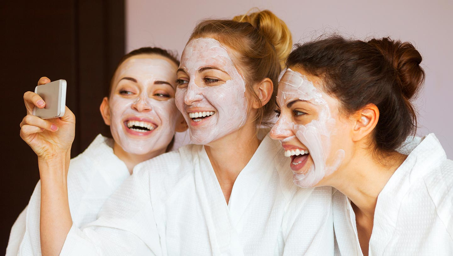 Teenagers taking a selfie in face masks