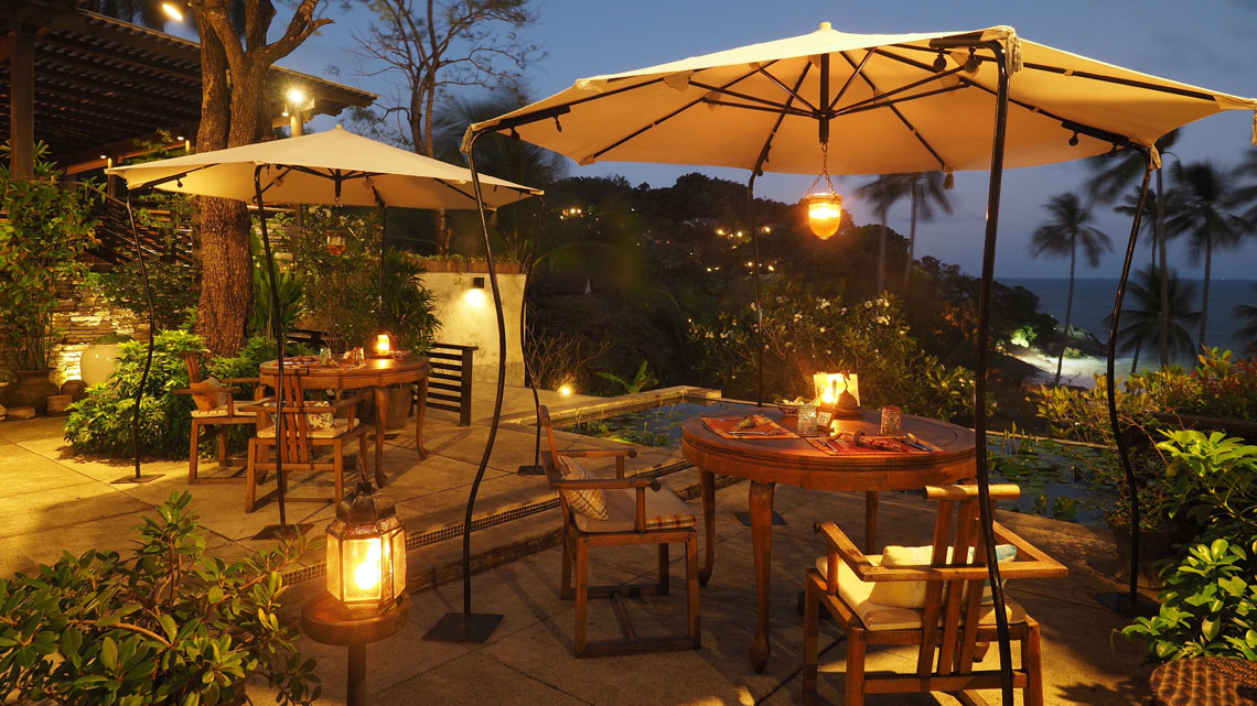 lantern-lit dining tables outside