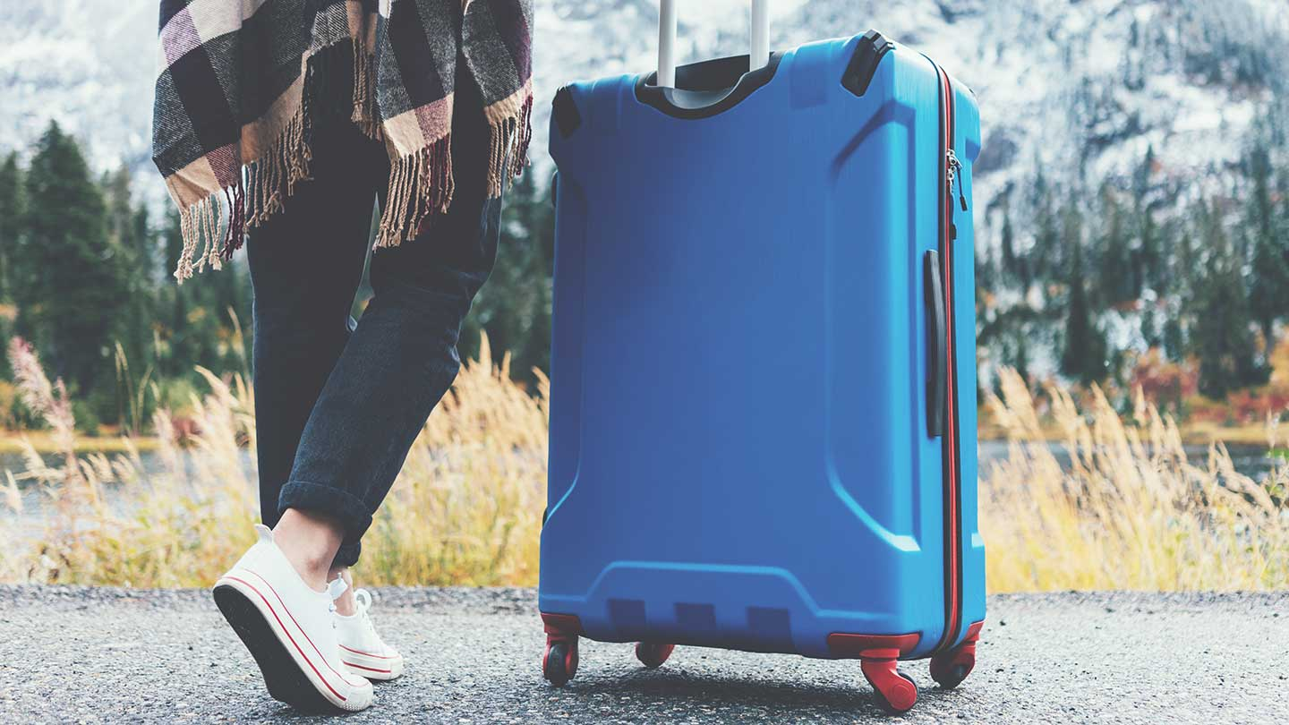 Woman-with-suitcase-header