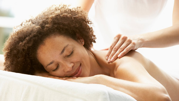 woman having her shoulders massaged