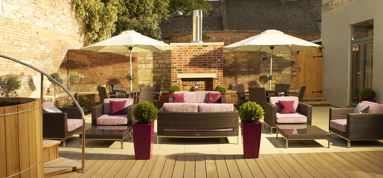 Outside_area_of_spa__decking__plants__furniture
