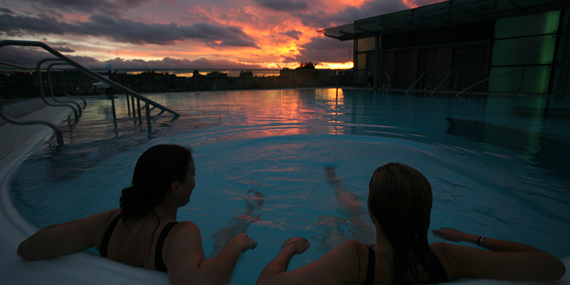 Thermae Spa rooftop pool at sunset
