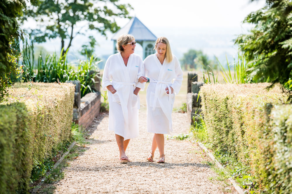 Two-ladies-taking-a-relaxing-walk-on-their-spa-day-lo-res