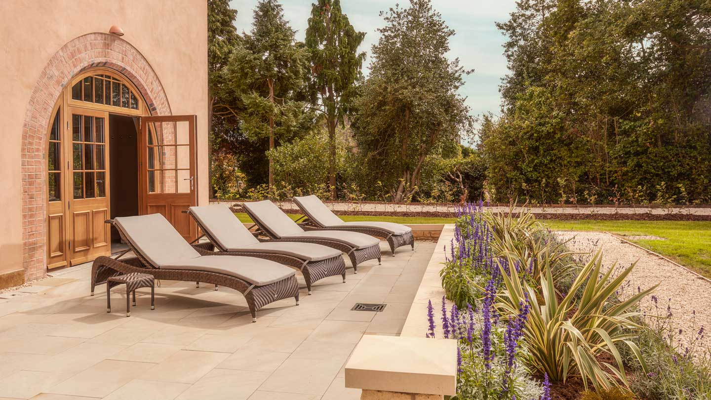 Three luxury lounge chairs outside in sunny weather