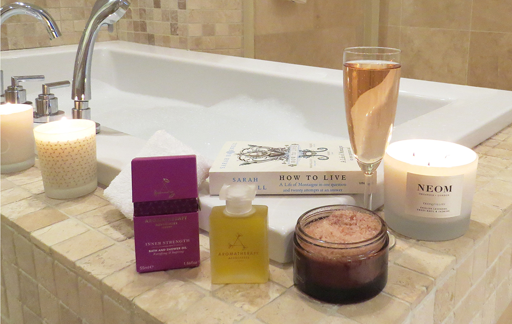a bath with candles and products