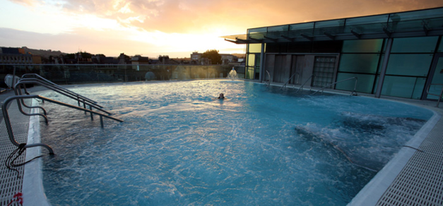 Thermae rooftop pool at sunset