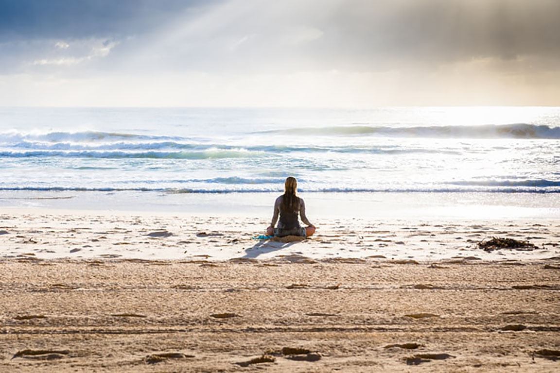 woman_meditating_at_beach_edited